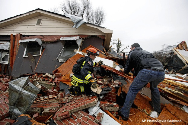 Firefighters search rubble